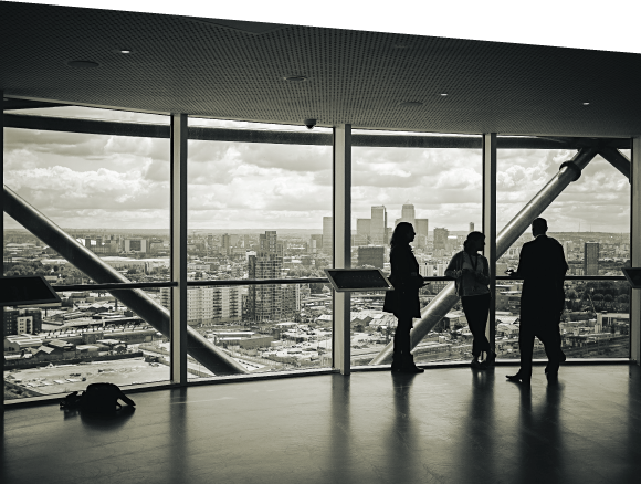 Entytle Black and White Silhouetted Interior Overlooking Cityscape image